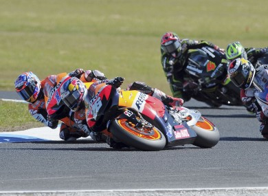 Dani Pedrosa, center front, of Spain begins to slide before a crash on turn 4 in front of teammate Casey Stoner of Australia, left, and Jorge Lorenzo of Spain, right, at the Australian MotoGP Grand Prix on Phillip Island.