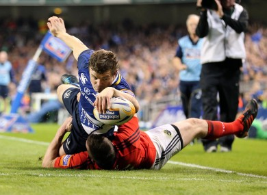 Leinster's Brian O'Driscoll scores a try against Munster.