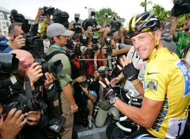 Lance Armstrong in front of the world's press after his final Tour win.