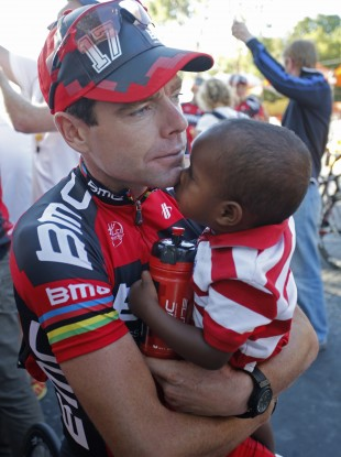 Cadel Evans holds his son Robel in Paris after the Tour finish this summer.