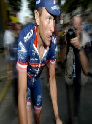 A photographer grabs a picture of Armstrong at the 2004 Tour de France.
