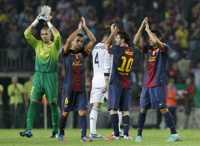 The Barcelona players applaud fans at the final whistle tonight.