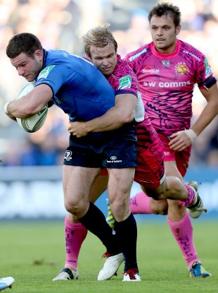 Leinster's Fergus McFadden tackled by Jason Shoemark of Exeter.