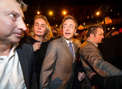 Leader of the NV-A party Bart De Wever, center, arrives at the NV-A election party after they won the city elections in Antwerp, Belgium, on Sunday Oct. 14, 2012.