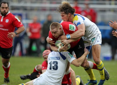 File photo: Vosloo (right) tackles Tom Court in the Heineken Cup meeting with Ulster in January.