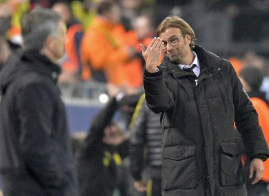Dortmund head coach Juergen Klopp, right, reacts beside Real's manager Jose Mourinho.
