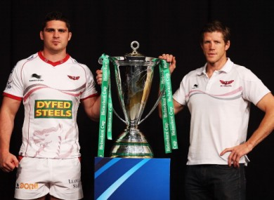 Scarlets Director of Rugby, Simon Easterby (right) and captain Rob McCusker pose with the Heineken Cup yesterday.
