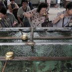 Elderly women rinse their mouths with holy water at a shrine in Tokyo. The UN Population Fund has urged governments to build safety nets to ensure that older people have income security and access to essential health and social services as the world's elderly population grows. The UN agency said discrimination toward and poverty among the aged are still far too prevalent in many countries. It released its report Monday, Oct. 1, 2012 in Tokyo, capital of the world's fastest-aging country. (AP Photo/Itsuo Inouye)