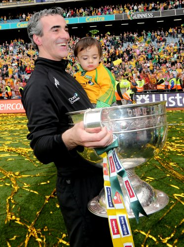 Jim McGuinness and his son Jim Jr with the Sam Maguire 23/9/2012