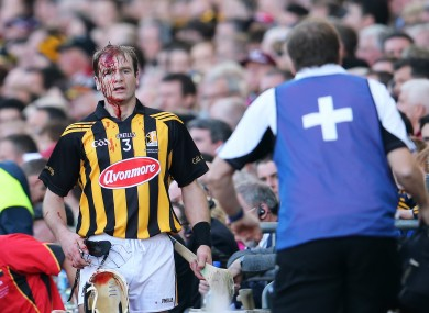 Kilkenny's JJ Delaney leaves the pitch for a blood injury on Sunday.