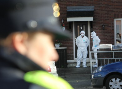 A Garda forensic team investigate the scene where John Wilson was shot dead