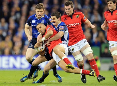 Leinster's Jonathan Sexton tackles Simon Zebo of Munster.