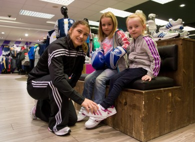 adidas ambassador Katie Taylor pictured with Seren Evans, 5, and Éamha Ledwith, 5, in the newly refitted Life Style Sports store at Dundrum Town Centre.