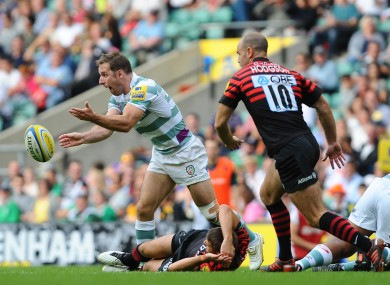 Tomás O'Leary spins a pass against Saracens.