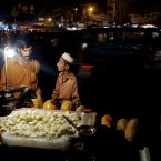 A Pakistani fruit vendor sells melon in downtown of Rawalpindi, Pakistan. (AP Photo/B.K. Bangash)