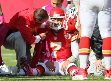 Trainers assist Kansas City Chiefs quarterback Matt Cassel (7) during the second half of an NFL football game against the Baltimore Ravens at Arrowhead Stadium in Kansas City. 