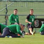 Robbie Keane and Simon Cox stretch.