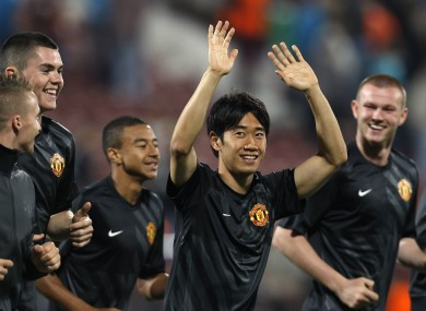 Manchester United's Shinji Kagawa, second from right, salutes supporters that were chanting his name in Cluj.