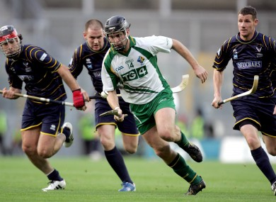 Ireland's Shane Dooley surrounded by Scotland defenders during the 2010 Hurling/Shinty International.