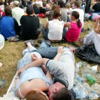 Fans take a break during Queens of the Stone Age