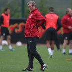England Manager Roy Hodgson has a pain in his back during the training session at London Colney, Hertfordshire.