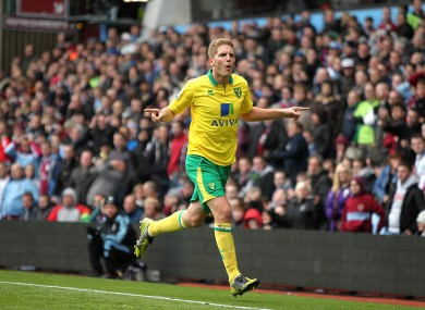 Norwich City's Michael Turner celebrates scoring his side's first goal of the game.