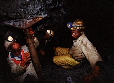 Miners work underground near Carletonville, South Africa (file photo)