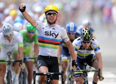 Mark Cavendish next to Australia's Matthew Goss celebrates a Tour de France stage win this summer.