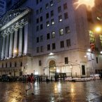 A man crosses the street in front of the New York Stock Exchange early this morning. (AP Photo/Richard Drew)