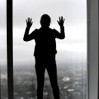 A visitor looks out across London, from the new visitor attraction 'The View from the Shard', due to open at the Shard, in south London. Photo: Nick Ansell/PA Wire