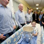 Nine-year-old TJ Flannery gets his hands on the Liam MacCarthy Cup.