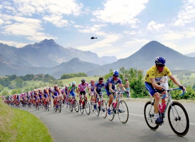 The pack rides with overall leader Lance Armstrong of Austin, Texas, right, in the lead, outside Mens, French Alps, on the way to climb the Ponsonas pass in 2002.
