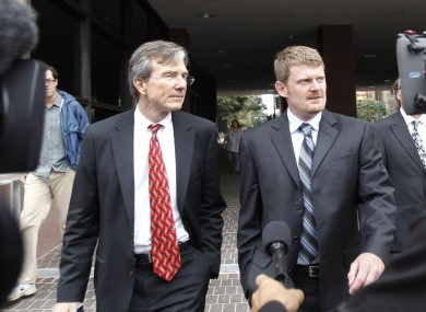 Floyd Landis, right, and his attorney, Leo Cunningham, leaving federal court in San Diego.