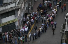 Poll open in Venezuela in tough election for Chavez