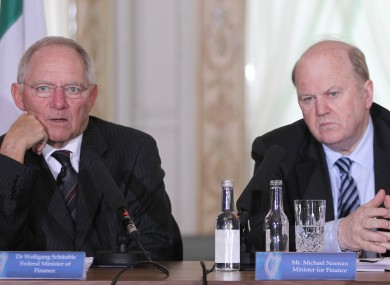 Wolfgang Schauble (left) speaks to reporters at Farmleigh after meeting with Michael Noonan and Brendan Howlin (out of picture).