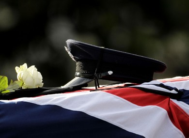 The hat and gloves of murdered prison officer David Black are placed on his coffin during his funeral service at Molesworth Presbyterian Chuch in Cookstown, Northern Ireland