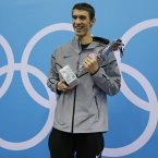 Now officially the most decorated Olympian ever, Phelps shrugged off initial poor form and suggestions he was past his sell-by date to make another indelible mark on the record books. (AP Photo/Matt Slocum)