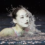 The North Korean team performs during the duets free routine final synchronized swimming event at the 9th Asian Swimming Championships, in Dubai, United Arab Emirates, Sunday, Nov. 18, 2012. The North Korean team wins a bronze medal. (AP Photo/Hassan Ammar)