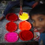 A street vendor boy arranges colors for sale during Tihar festival in Katmandu, Nepal. (AP Photo/Niranjan Shrestha)
