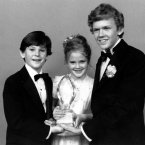Drew Barrymore, center, Henry Thomas, left, and Robert Macnaughton, the young stars of Steven Spielberg's movie