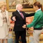 In his first year in office, President Michael D Higgins delighted everyone he met, including Olympic hero Katie Taylor, who didn't have such a bad year herself. (Photo: Laura Hutton/Photocall Ireland)