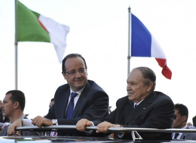 French President Francois Hollande, left, and Algerian President Abdelaziz Bouteflika