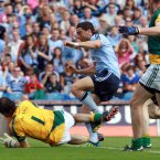 Raising the green flag. Dublin's Bernard Brogan scores his sides first goal of the game. (INPHO/Donall Farmer).