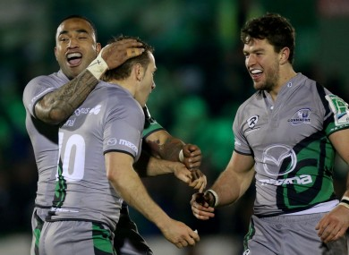Vainikolo and Poolman celebrate with Parks after his late drop goal.