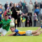 Balancing act. Leitrim's Daniel Beck keeps the ball in play despite the challenge of Dean Healy of Wicklow. The game in Carrick-on-Shannon sees Leitrim claim their first ever qualifier win. (INPHO/Ryan Byrne).