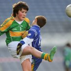 Kicking away. Eoghan Mac Laighean of Scoil Oilibheir (An Chul Mhin) loses his boot when tackled by Adam Gregg of Scoil Mhearnog (Portmarnock) in Croke Park.