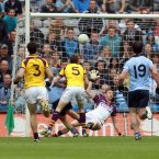 Hitting the net. Kevin McManamon is obscured from view but the Dublin attacker's contribution is vital as he raises the green flag that decides this Leinster semi-final. (INPHO/Donall Farmer).