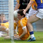Defensive agility. Antrim's Kevin O'Boyle does brilliantly to stop the ball from crossing the line in Semple Stadium. (INPHO/Ryan Byrne).