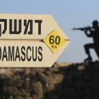 24 July 24: A sign showing the distances to Damascus and a cut out of a soldier are seen at an army post from the 1967 war at Mt. Bental in the Golan Heights, overlooking Syria. (AP Photo/Tsafrir Abayov)