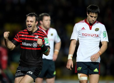 Neil de Kock celebrates as Munster's Conor Murray leaves the pitch at Vicarage Road.